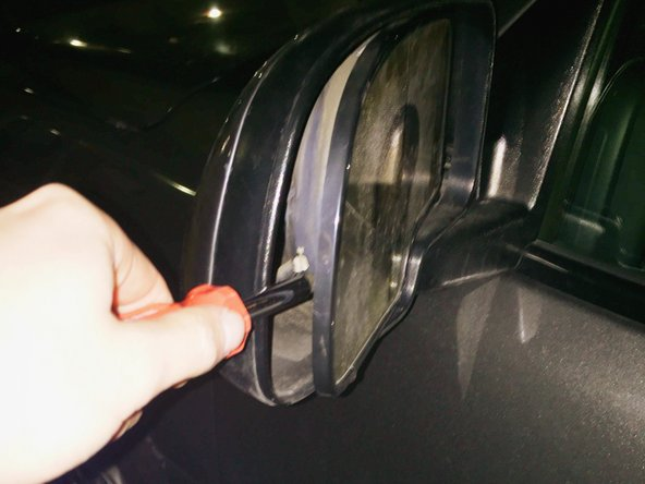 Insert the screwdriver on the left side of the mirror and apply force to release.