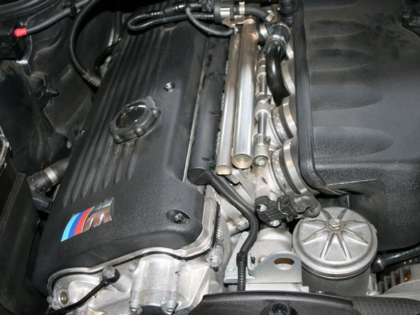 Open the hood to access the engine bay.