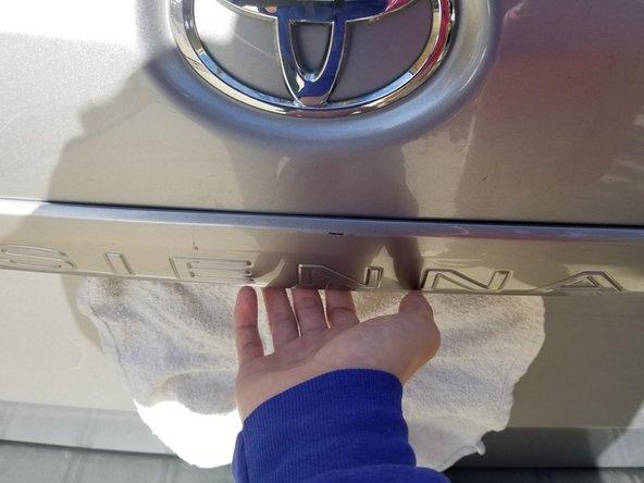 Open your trunk's door.