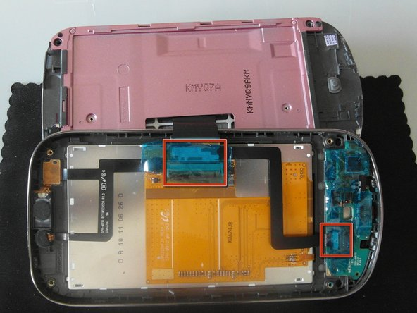 Once the screen bezel is removed from the slider case, the flex cable is connected in two places.