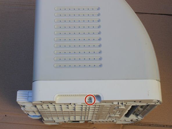 Remove the indicated Phillips M3 screw from the left side of the printer