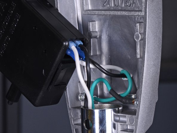 Pull the wires connected to the interlock assembly straight out of their connectors.