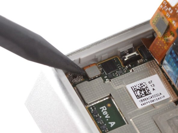 Use a spudger to pry up and disconnect the battery flex cable.