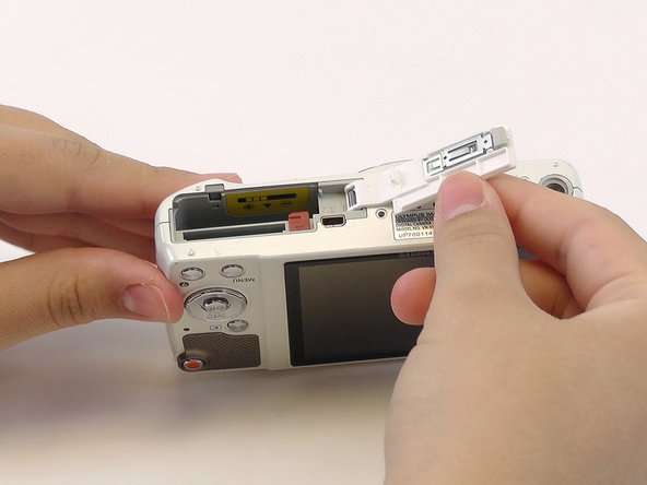 Use the plastic opening tools and your fingers to pry the front plate from the camera.