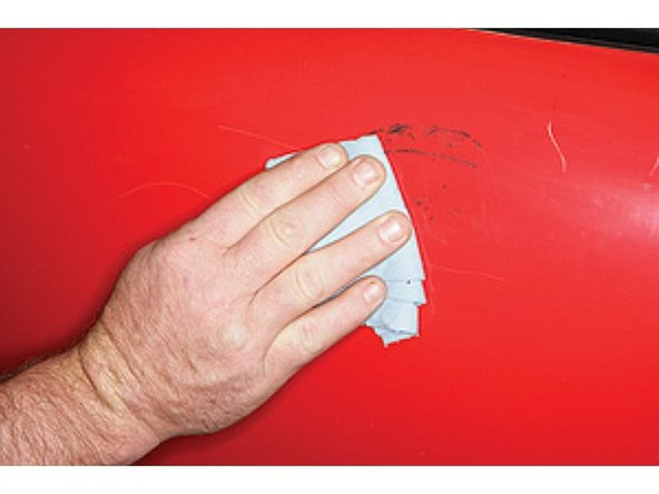 Wipe the shoe polish over the panel. This fills the scratches with polish.