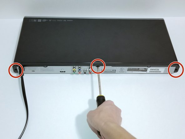 Remove the three 6.4 mm Phillips #1 screws on the back of the device with a Phillips head screwdriver.