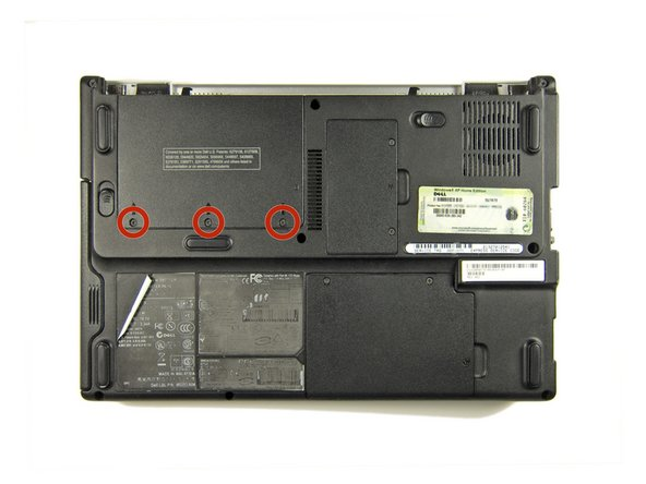 Remove the three Phillips screws securing the hard drive cover.