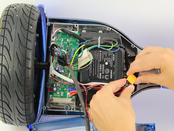 Unplug the battery from the gyroscope/motherboard by holding the yellow connector and pulling apart.