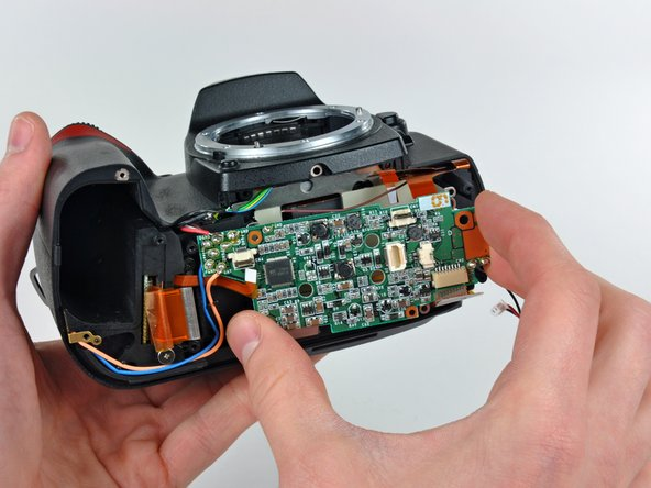 Remove the DC/DC board from the D70, minding any cables that may get caught.