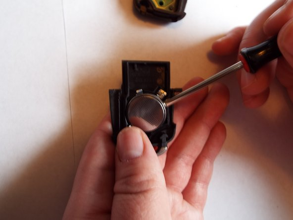 Use a spudger to remove the battery.