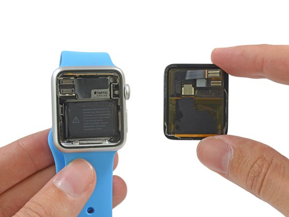 Houston, we have separation. With the display panel removed, we quickly spy two highly-advertised Apple Watch features: the Taptic Engine and the Digital Crown.