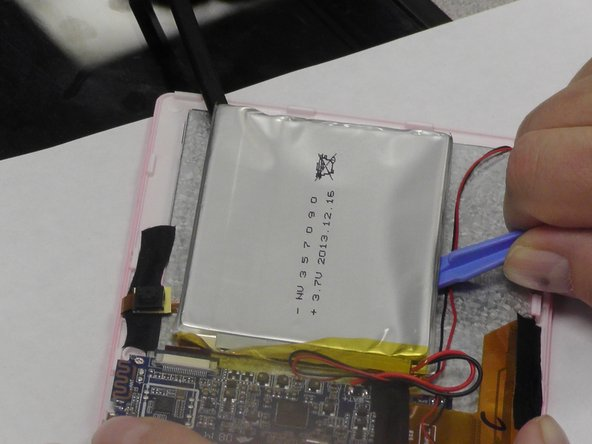 Carefully pry up the battery by wedging the plastic opening tool under the battery. It is glued to the screen so it will be a delicate removal process.