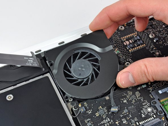 Lift the fan out of the upper case.