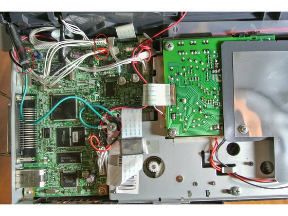 To change or remove the ADF-Scanner-Unit, you'll have to remove the cables I've marked in the first picture.