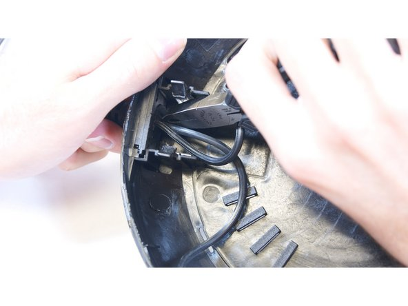 Using pliers, rotate the power cord clockwise to align it with the hole and simply pull it through.