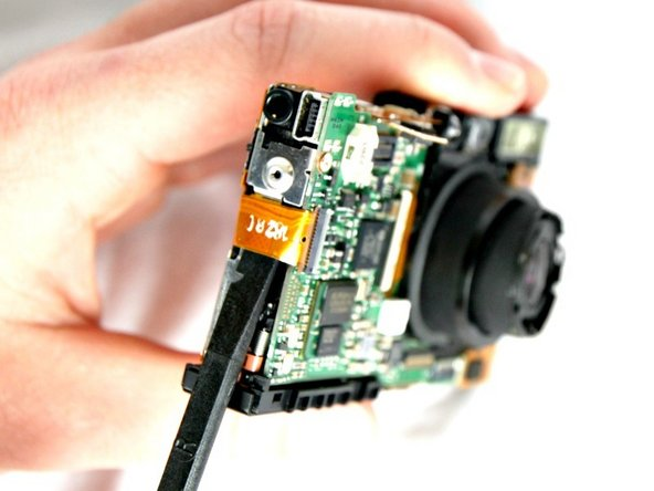 With a spudger disconnect the orange connector ribbon as shown.
