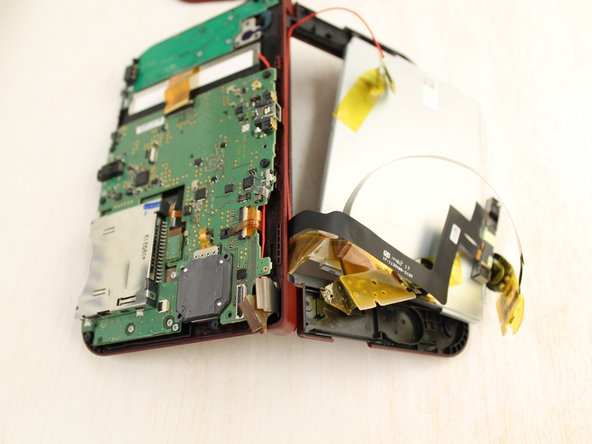 The cables to the LCD are attached to the lower part of the DS's motherboard.