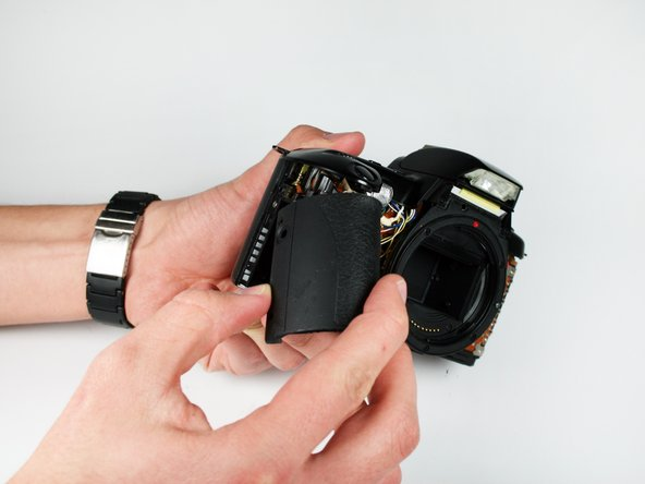 Once the grip is loose, use your fingers to remove it from the camera.