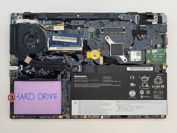 Remove the single 3 mm screw holding hard drive bracket in place.