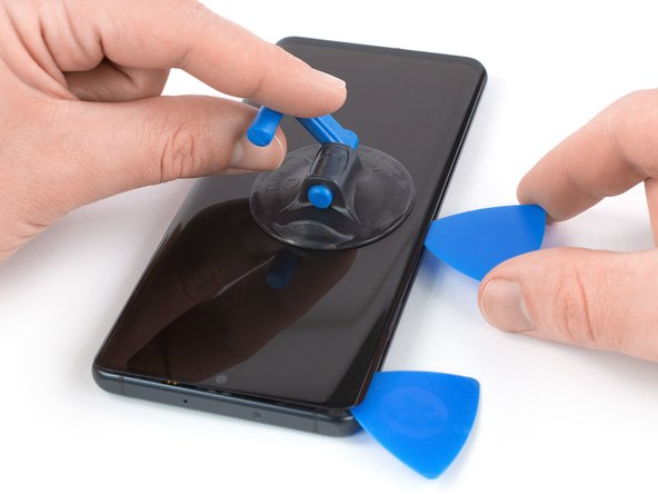 Insert a second opening pick and slide it to the bottom left corner of the phone to cut the adhesive.
