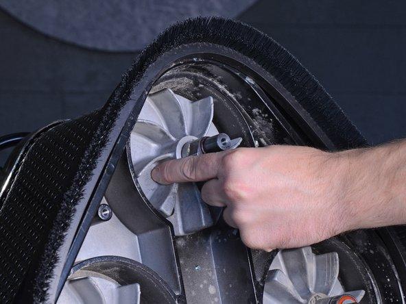 Slide the dust fan straight off of the motor shaft.