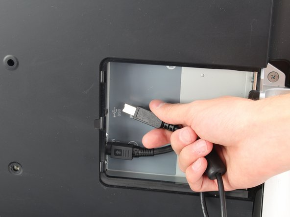Unplug any cables from the USB, power, display or DVI-D ports  by  gripping the  cord by the connector and pulling straight out of the port.