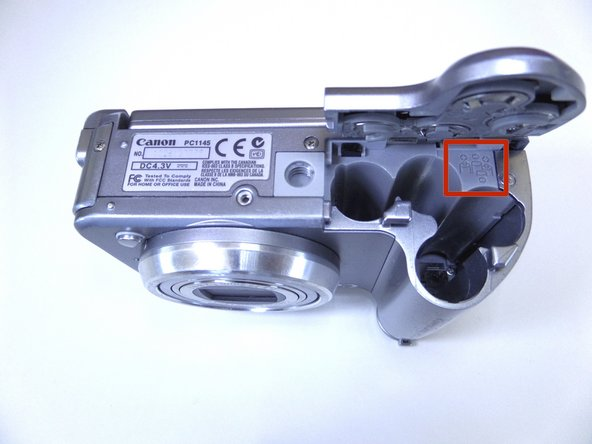 Insert AA batteries according to the diagram printed on the camera.