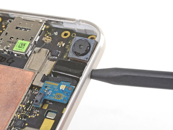 Insert the point of a spudger into the headphone jack port and pry upwards to loosen the port from its socket.