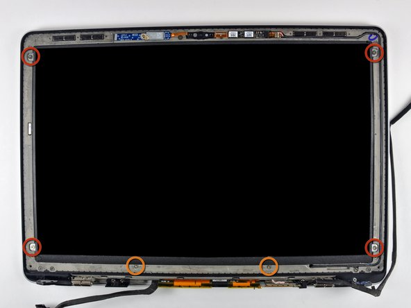 Remove the following six screws securing the LCD panel to the front bezel: