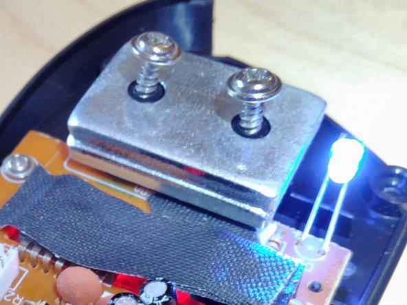 Remove 2 screws to lift-up the two metal weights