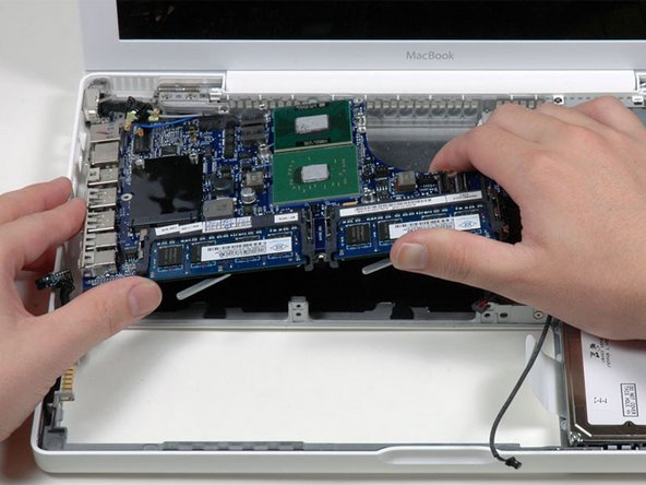 Lift the logic board up from the right side, and slide it up and out of the computer.