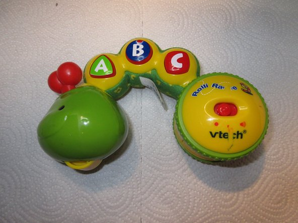 This is Vtech Rolliraupe, a electronic toy which talks and sings. It has three buttons like A, B and C which trigger different sounds or songs.