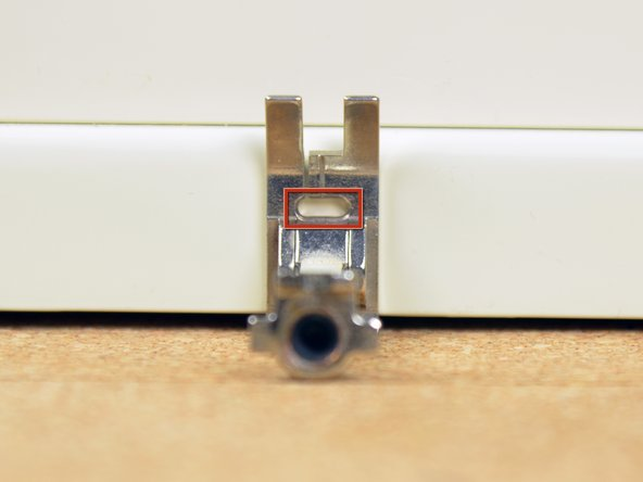 Fit your sewing machine with a presser foot that has a wide hole.