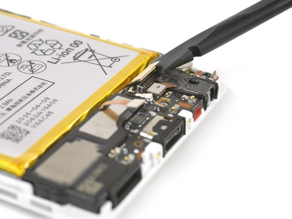 Disconnect the motherboard flex cable and the antenna cable.