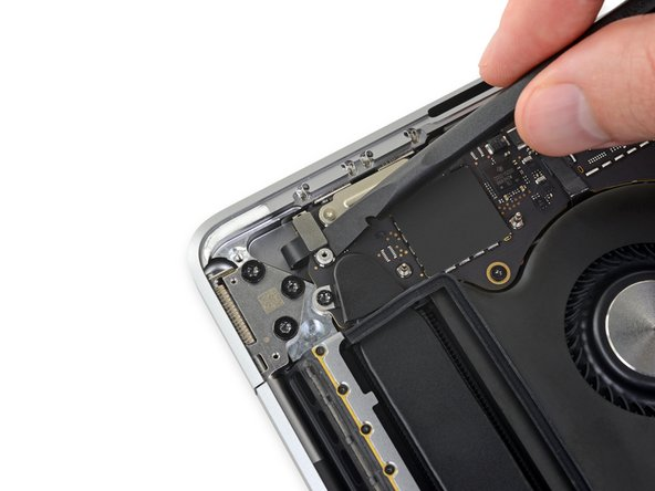 Disconnect the Touch Bar digitizer cable by prying it straight up from the logic board.