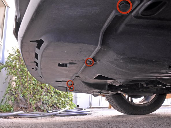 Locate the plastic push pins along the bottom of the bumper.