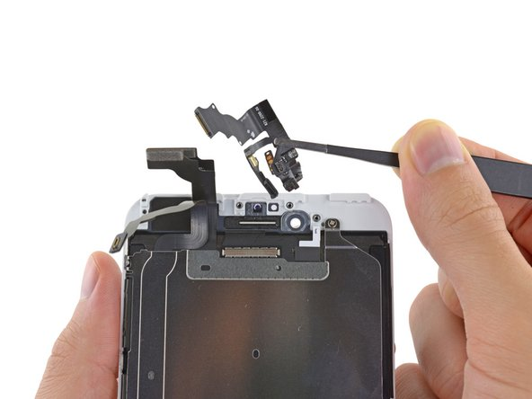 Remove the front-facing camera and sensor cable assembly off the display assembly.