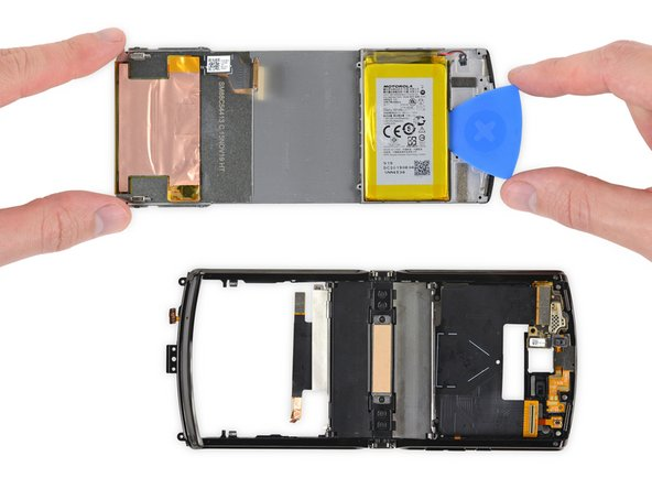 With the pOLED display removed, we're a bit dismayed that the battery comes with it. Prying against this flexible sheet for a battery swap doesn't seem ideal, even if the battery is in a metal caddy.