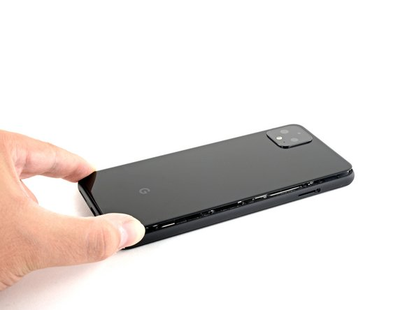 Once you have sliced around the perimeter of the phone, carefully lift the right edge of the back cover, opening it like a book.
