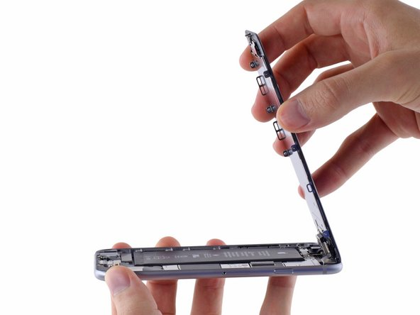 Open the iPhone by swinging the home button end of the front panel assembly away from the rear case, using the top of the phone as a hinge.