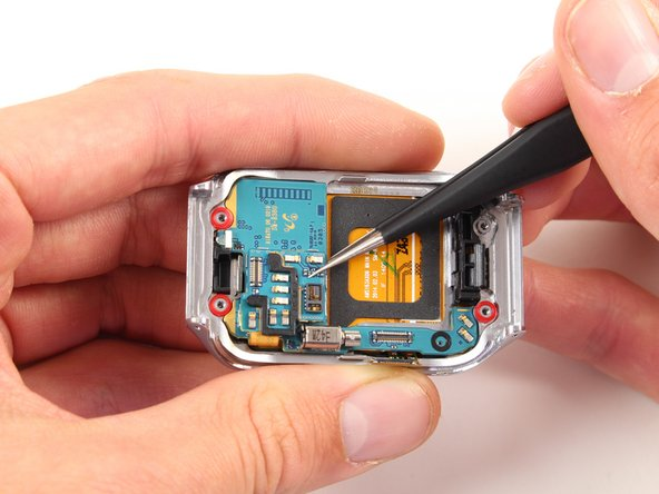 Once the safety belt is removed, use tweezers to take the motherboard out of the Gear 2.