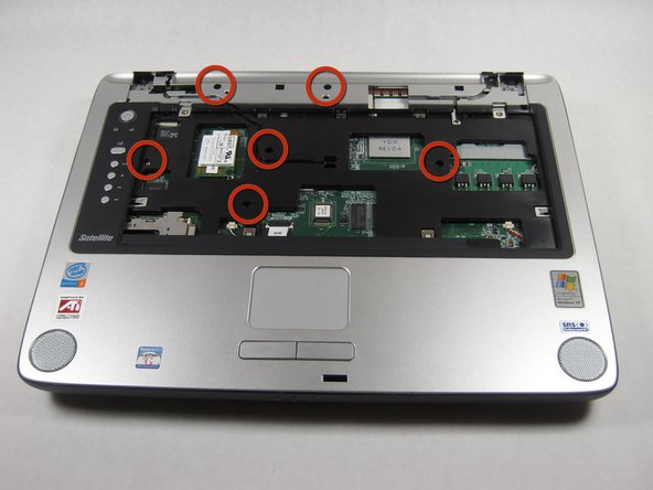 Use the screwdriver to remove  six 8.6 mm screws from the top of the case.