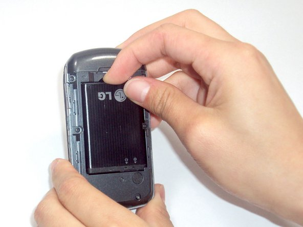 Insert your finger into the small indentation above the battery.