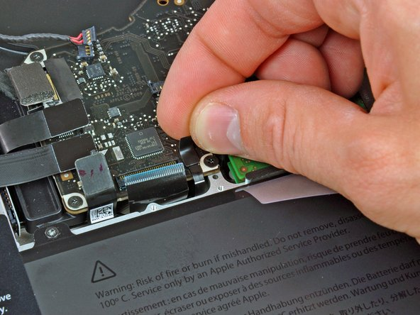 Peel the small strip of black tape off the keyboard backlight ribbon cable socket.
