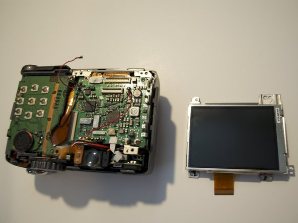 The LCD is now free from the camera and you are now able to replace it with the new screen.
