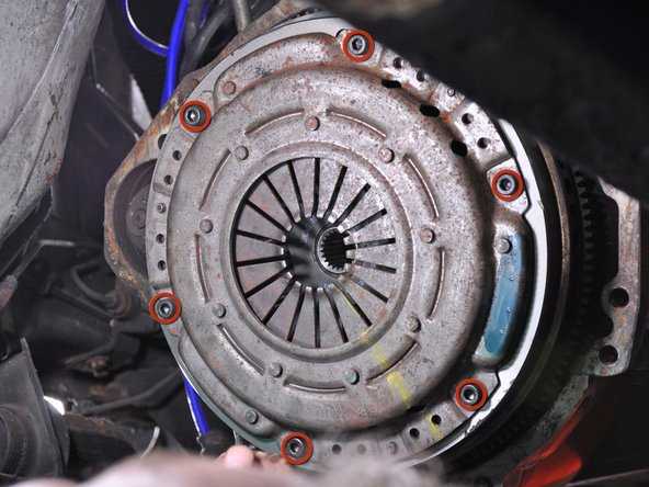Remove the 6 allen bolts securing the pressure plate to the flywheel.