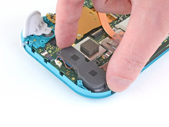 Use your fingers to lift and remove the right speaker module cover.