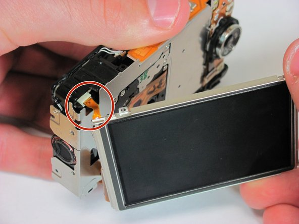 Slide the LCD screen to the left of the camera and then gently pull the LCD screen away from the camera.