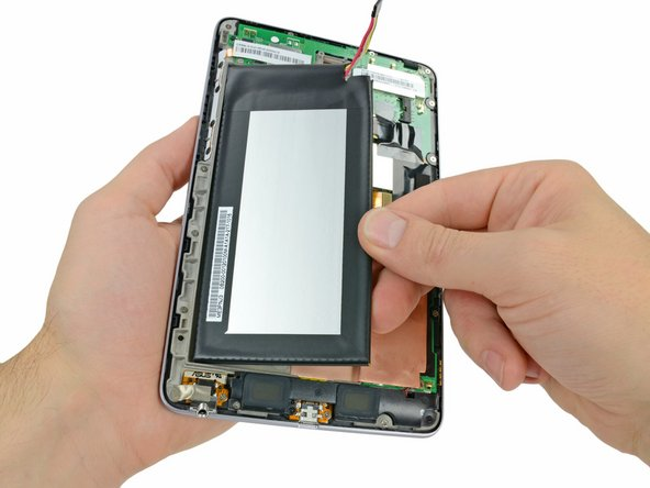 Grasp the lower right corner of the battery and rotate it upwards to remove it from the front panel assembly.