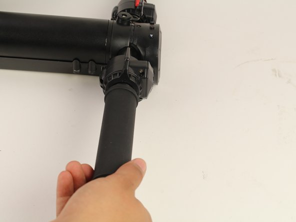 Turn the right handle grip counterclockwise.
